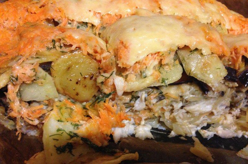 Белая рыба с овощами в духовке под сырной шубкой