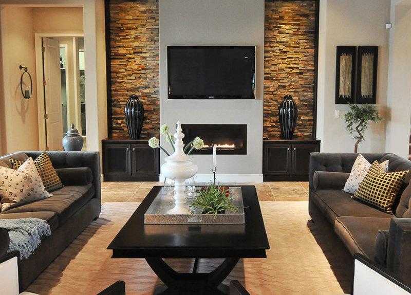 Фото дизайна гостиной с камином