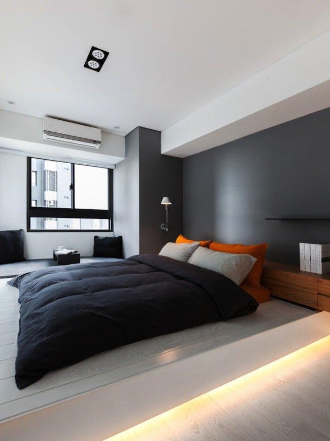 Спальня в стиле минимализм с оранжевыми деталями в дизайне