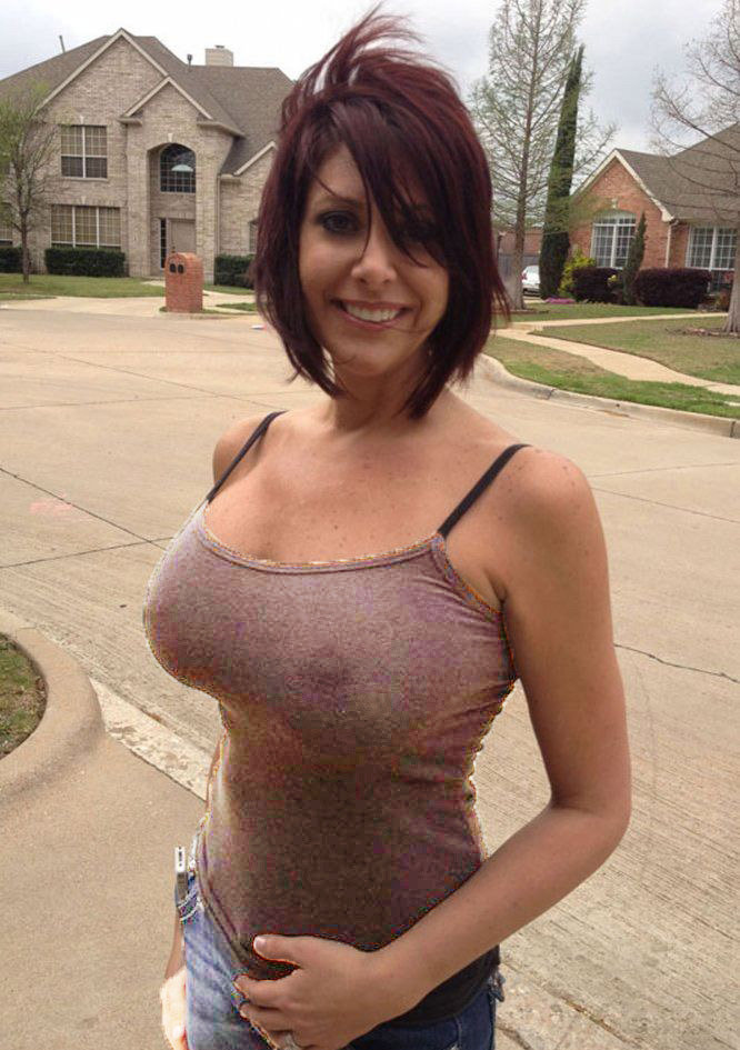 Girl in tight wife beater