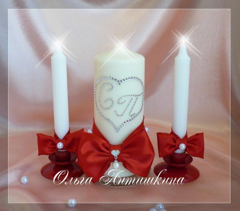 свечи с красными бантами