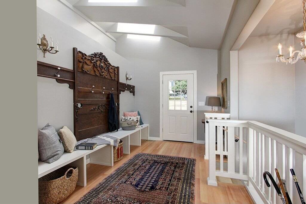White Bench With Wicker Baskets Underneath Wood Headboard Repurposed Hangers Staircase To The