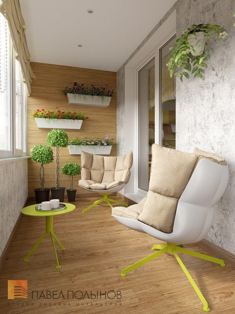 Просторный интерьер лоджии (балкона) с кофейным столиком и к.