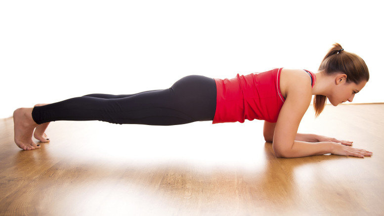 A picture of a woman doing a plank exercise