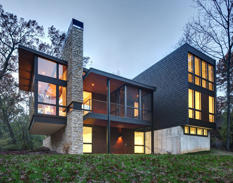 A new contemporary house in Wisconsin is covered in stone and shingles