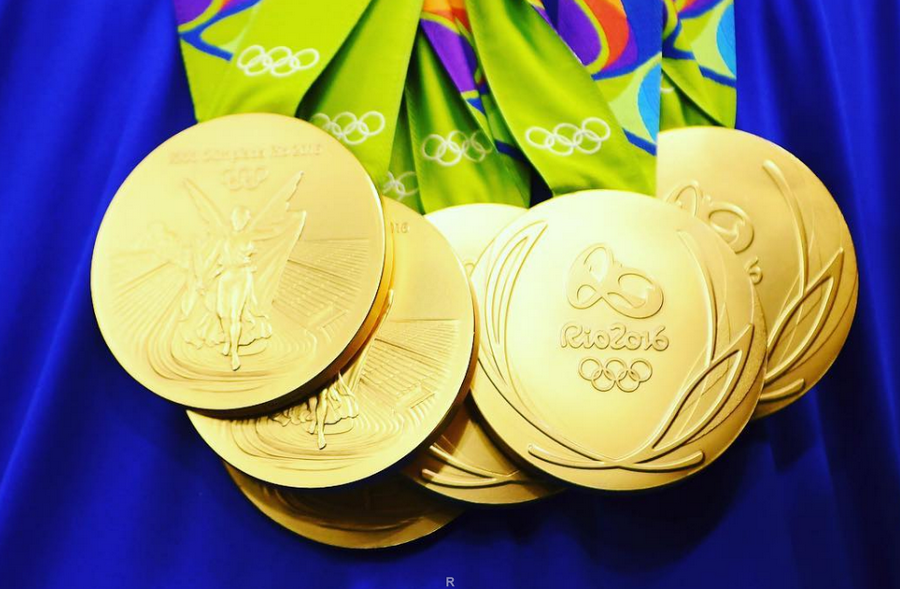 кучу медали олимпийских игр фото этого