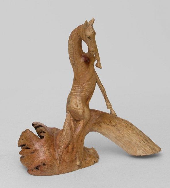 картинки с деревянными статуэтками были