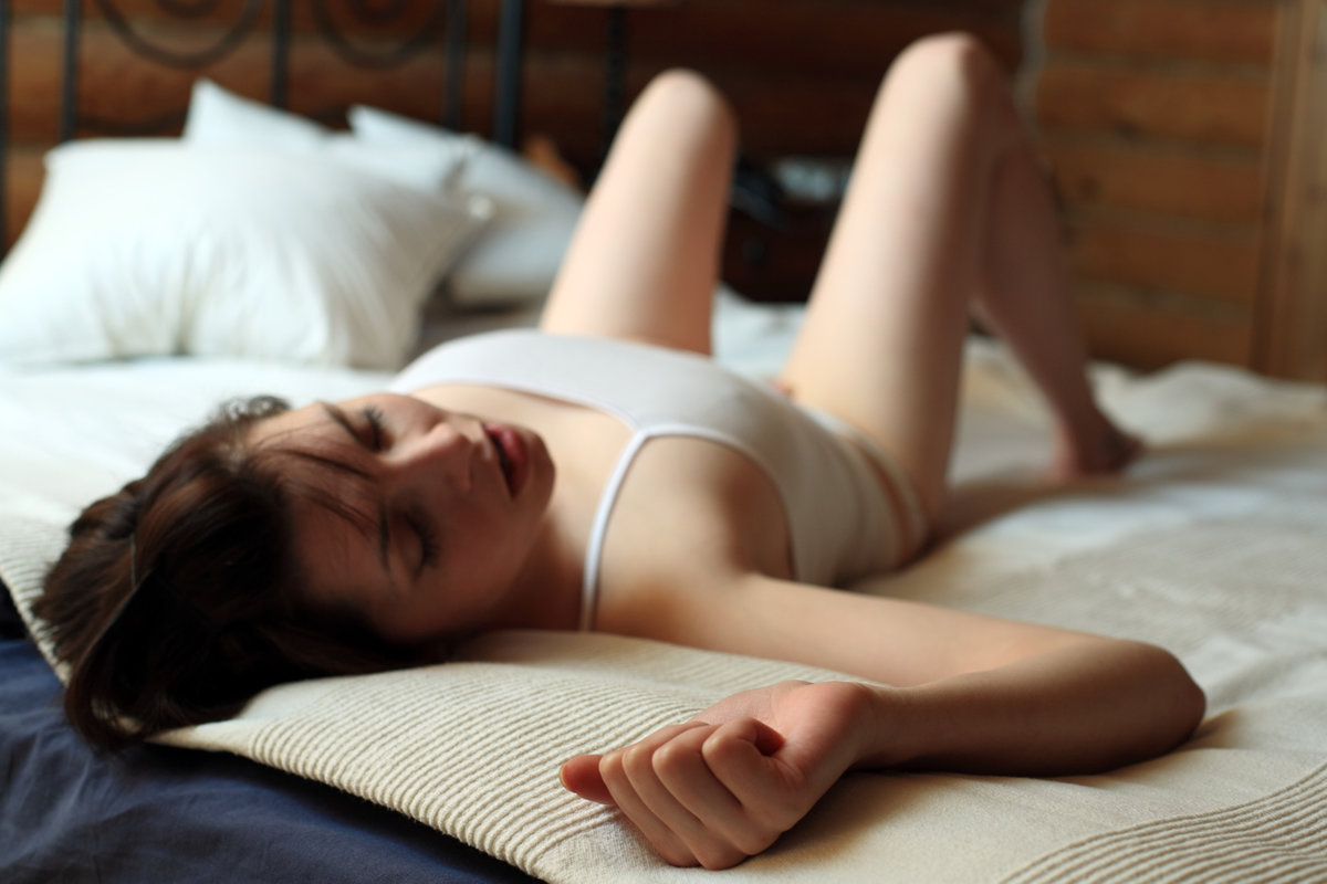 adult-brunette-woman-masturbating-tan-lines-thong-nude