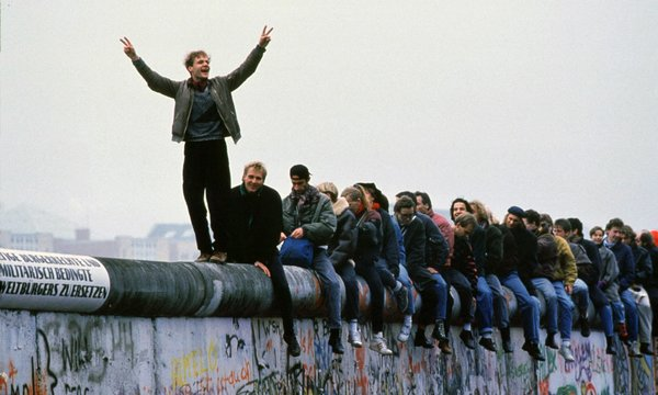 West Germans celebrate the fall of the Berlin wall, November 1989. Photograph: Stephen Jaffe/Getty Images
