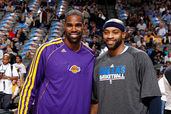 Antawn Jamison #4 of the Los Angeles Lakers and Vince Carter #25 of the Dallas Mavericks pose for a picture before the game on November 24, 2012