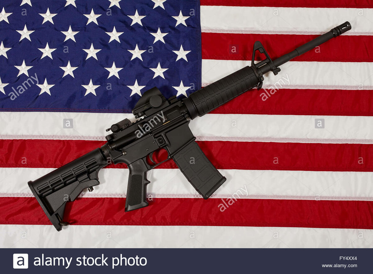 https://www.dreamstime.com/royalty-free-stock-images-ar-rifle-few-bullets-laying-american-flag-shallow-depth-field-image30070239
