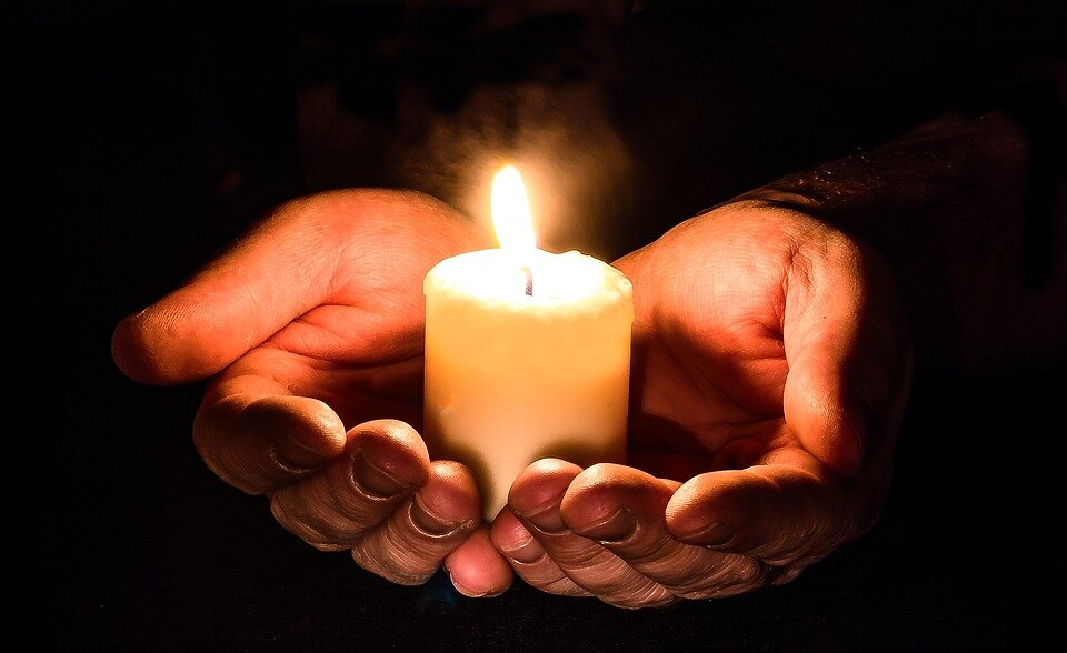 https://pixabay.com/photos/hands-open-candle-candlelight-1926414/