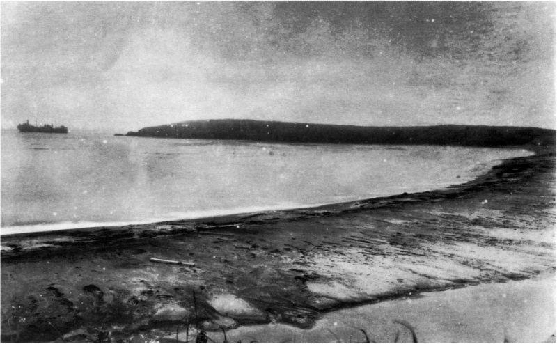 The beach on the Shumshu island, where the landing of the Soviet troops took place.  View of Cape Kotomari.  To the left, the Soviet tanker Mariupol is seen sitting aground.