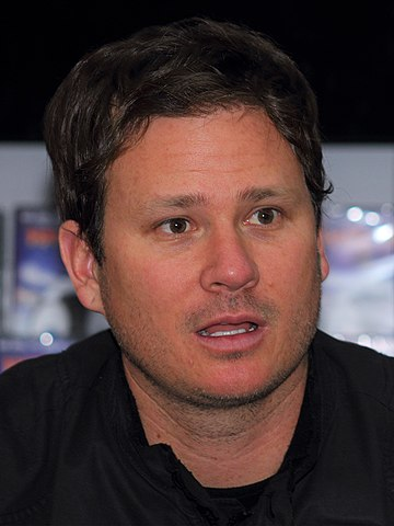 By User:A.Savin - A cropped version of File:Angels&Airwaves Hansaring 06 Tom DeLonge.jpg, CC BY-SA 3.0, https://commons.wikimedia.org/w/index.php?curid=83898104