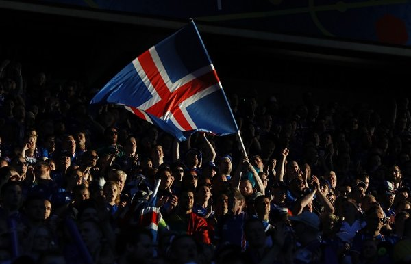 Football Soccer – Portugal v Iceland – EURO 2016 – Group F – Stade Geoffroy-Guichard, Saint-?tienne, France – 14/6/16 Iceland fans with a flag REUTERS/Jason Cairnduff Livepic – 14437610