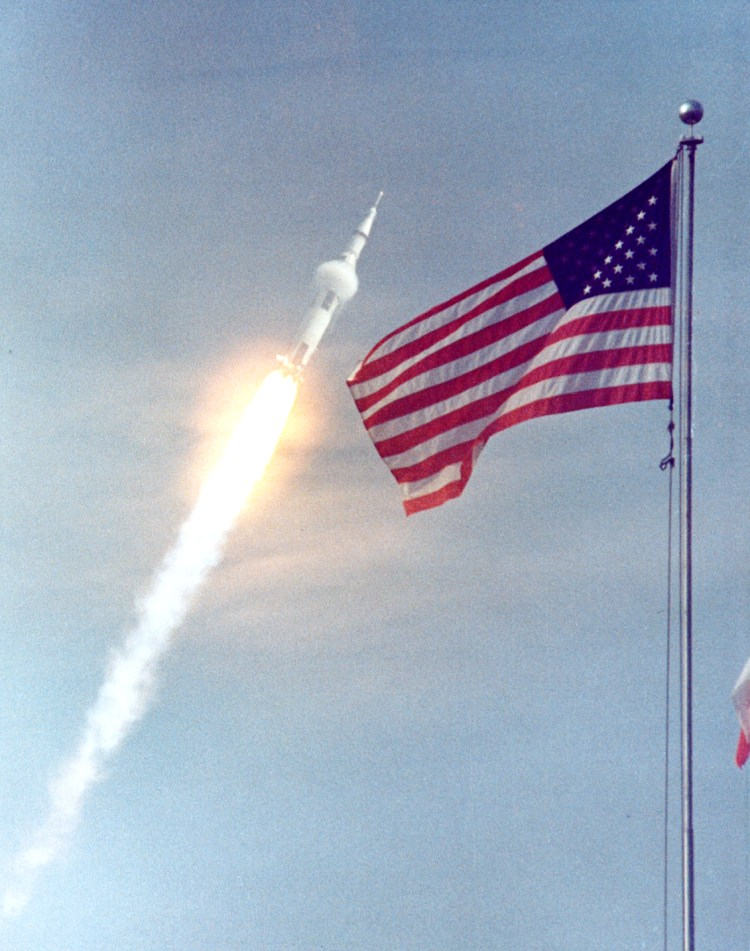 KSC-69PC-397 - Apollo 11 after pitchover. Note the condensation cloud that has formed in air expanding aft of the first-stage/second-stage transition. 16 July 1969. Scan by Kipp Teague.