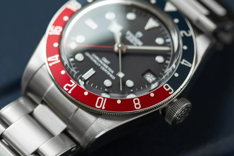 Close-up of aluminum bezel and domed sapphire crystal