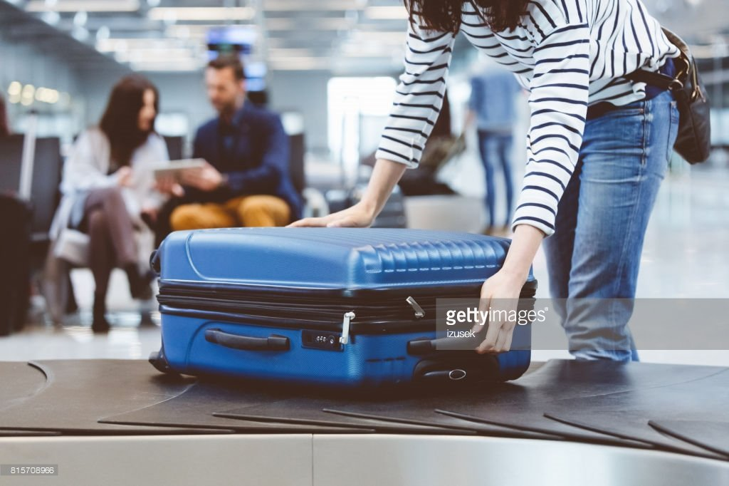 woman leaving with luggage - 1024×682