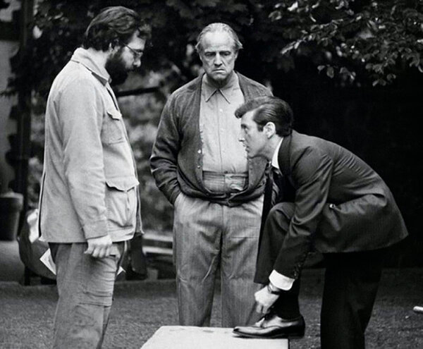Coppola with his two leading actors. The Godfather would launch Pacino's film career and revitalize Brando's. Photo by Steve Schapiro. 1972