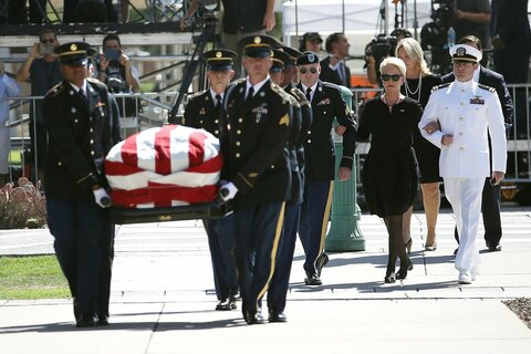 Cindy McCain walks into the Arizona State Capitol with sons James McCain and Jack McCain