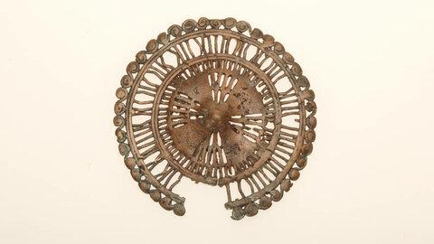 Нашивная бляшка. 2-я половина I тыс. до н.э. Медный сплав