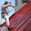 Покраска металлической крыши дома