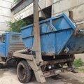 Вывоз мусора контейнером: 8 кубов